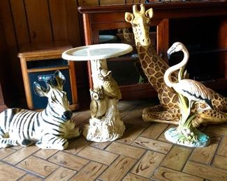 Statues.  Zebra, giraffe, flamingo.  Owl pedestal table