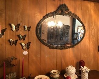 Victorian oval mirror.  Brass butterfly decor
