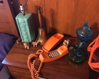 MCM nite stand.  Orange phone, depression glass candy dishes, teal lamp
