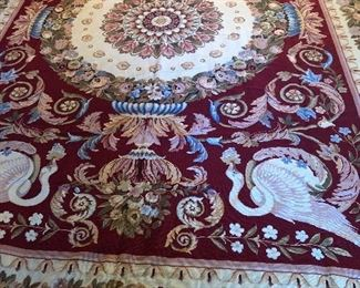 Large hand stitched rug.  On consignment