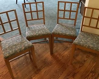 A set of four chairs. Made in Tacoma Washington.