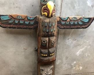 This magnificent carved totem pole stands 9' tall with a wingspan of almost 7' - we have him on dollies in the garage, but talk about a statement piece ready to shine!