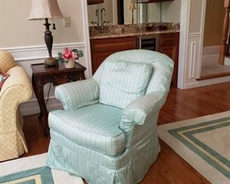 One of a pair slipcovered armchairs