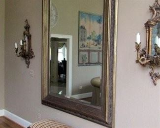 XXL framed mirror, oversized sconces, and carved bench