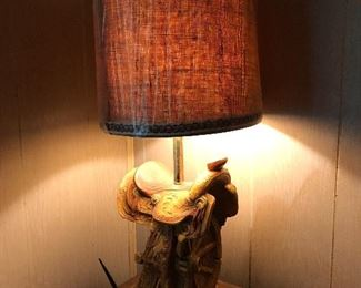 1 of a matching pair of vintage western table lamp with western saddle base