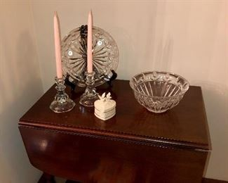 Mahogany tea table cart with removable glass shelf to become a tray.  Antique candle sticks has a matching bowl