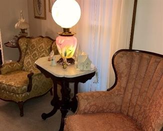 Vintage 1920-40 wingback chair, French provincial club chair, Eastlake turtle shell marble top table, early GWTW pink and yellow converted oil lamp. Lamp has a floral design that we think is peace lilies