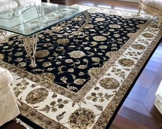 This particular rug is hand-tied, a silk/wool blend, expertly crafted in India.  It's gorgeous, and measures 10'x14'