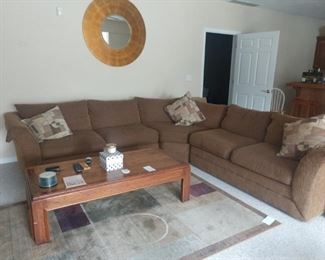 Sectional * Coffee table * Throw Pillows* Area Rug*        NOTE****MIRROR ON WALL NOT FOR SALE*********