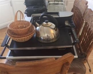Counter height stools with cane seats, kitchen items