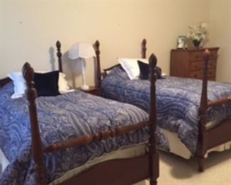 Matching twin four poster beds, Ralph Lauren comforters