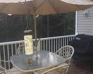 Glass top patio set with seat cushions