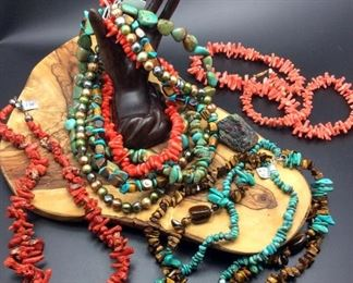 Semi-precious stone necklaces including coral, turquoise, tiger's eye and freshwater pearls, 50% off