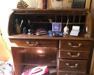 roll top desk with big-handed brass knobs, ammiright? Ooh, vintage train case!