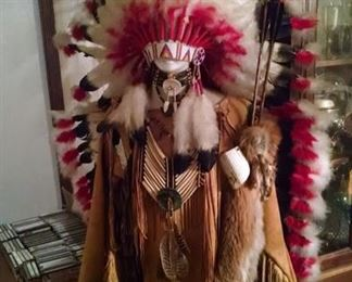 Native American headdress and  leather outfit