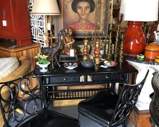 Black lacquer faux bamboo writing table. Pair of iron side chairs.