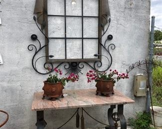 Elaborately wrought iron mirror. Heavy-gauge iron console, stone top.
