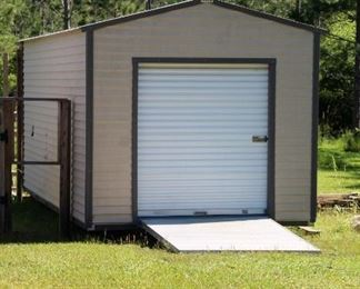 Metal building with roll up door
