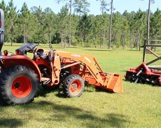 2014 Kubota tractor with front end loader, cultivator and bush hog