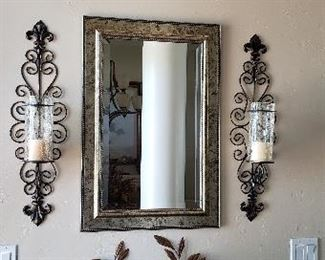 Framed mirror. Scroll metal candle sconces. Metal leaf wall plaque.  Decorative wood box.