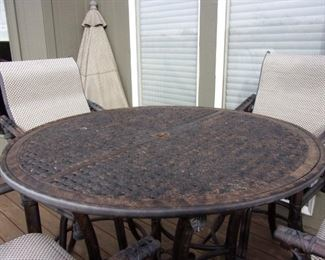 Quality Luxury brand Castelle Patio Table and Four swivel bar chairs $1,000. OUR PRICE OBO/New it is over $5,000 Table alone new is $1,100.00 see link https://www.patioliving.com/castelle-sienna-tables-cast-aluminum-round-patio-bar-table-pfdch42 Similar Chairs over $1,200 each see link https://www.patioliving.com/castelle-resort-fusion-sling-dining-patio-bar-stool-pf9d99