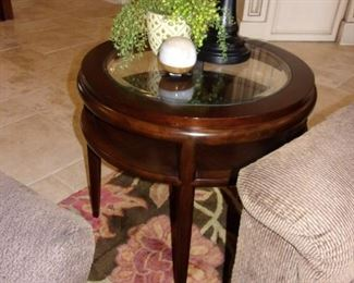 Beveled edge glass top end table with  shelf