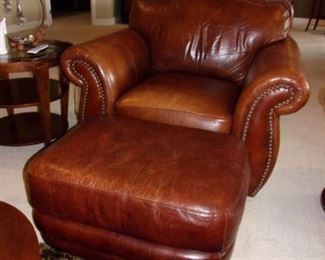 Leather rolled armed/nailhead trimmed Sofa/couch with matching chair and ottoman! Excellent condition! PLEASE NOTE PRINT FABRIC CUSHIONS ON SOFA ARE CUSTOM AND THIS SOFA COMES WITH ORIGINAL LEATHER COVER FOR CUSHIONS ON SOFA:)