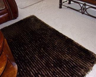 Large thick dark chocolate area rug