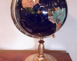 Globe with precious stone inlay