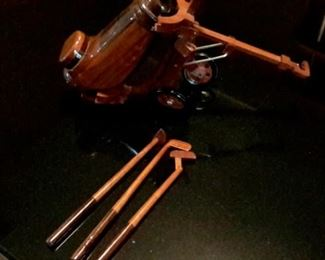 Carved wood golf clubs and carrier