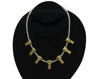32. Gold and Emerald Necklace with Aztec Figural Motif