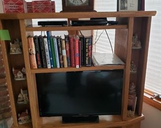 TV stand, mantle clock (TV and books not available)