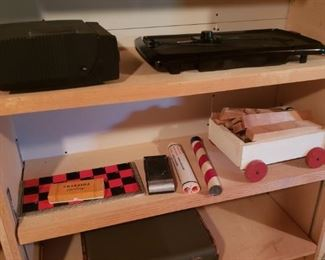 Checker board, toys, vintage suitcase, projector, electric skillet
