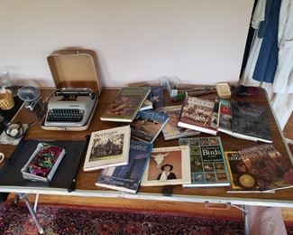 Coffee table books, vintage typewriter, folding table