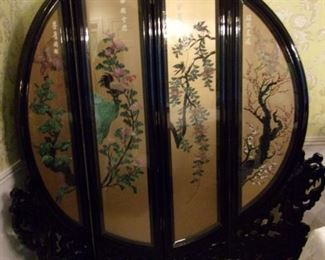 Black lacquer Asian screen hand carved - Tapered on the edge to fit the circular shape, the symbol of eternity in Feng Shui, this four-panel floor screen is exquisitely hand-painted and decorated with mother of pearl, jade, and coral to exhibit a panoramic view of a Chinese social scene in ancient time. Treasured for not only its artistic quality but also its contribution in Feng Shui, according to which a rectangular room should be balanced with a prominent round object such as this round floor screen. This sells online over $1,000 our price is MUCH BETTER!