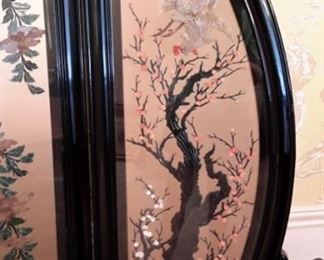 Black lacquer Asian screen hand carved - Tapered on the edge to fit the circular shape, the symbol of eternity in Feng Shui, this four-panel floor screen is exquisitely hand-painted and decorated with mother of pearl, jade, and coral to exhibit a panoramic view of a Chinese social scene in ancient time. Treasured for not only its artistic quality but also its contribution in Feng Shui, according to which a rectangular room should be balanced with a prominent round object such as this round floor screen.