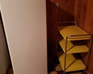 Small fridge; vintage metal cart.