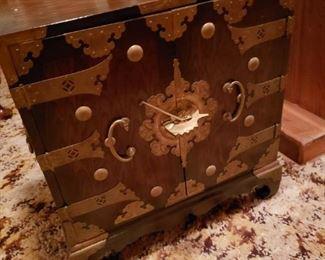 Wood cabinet with doors, unique hardware.