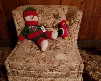 Vintage chair; WILD stuffed animals.