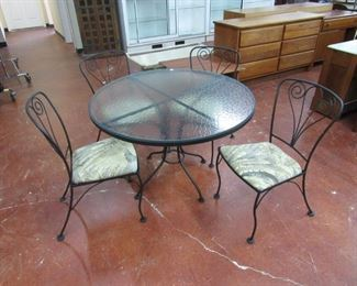 Iron patio set with 4 matching chairs