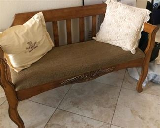 Unique upholstered carved wood bench