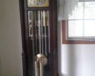 Grandfather clock with lots of pedigree-details to follow:  Colonial-manufacturer.  6 tubes. 2 sets of chimes-one for the hours one for the 1/4 hours.  Westminster and Canterbury.  Phases of the moon.  Stunning carving on the front