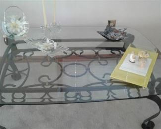 Beautiful heavy beveled glass coffee table ornate metal base with some funky mid century-70s accessories. The yellow lucite cheese and cracker are my favorite-altho the stone mushrooms are fun.