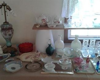 A bit of everything-so something for everyone!  Perfume bottle collection, Art glass, tea pots, china -so pretty