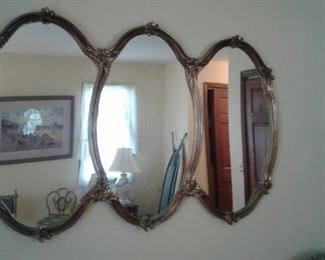 Triple mirror-the ironing board reflection is a nice touch-hmm?