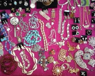 Bling!  Many signed pieces.  Dior, Trifari, Sarah Coventry, Coro, sterling and a bit of gold!