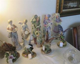 Just a sample of the many Bisque figures that includes birds, animals, several different couples, children and babies.