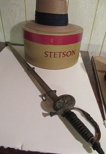 Stetson hat  and sword