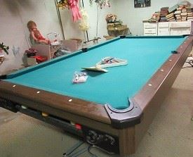 Pool table includes 4 cues, and other equipment.