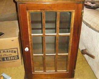 Lighted curio cabinet - meant for a corner. Two glass doors.